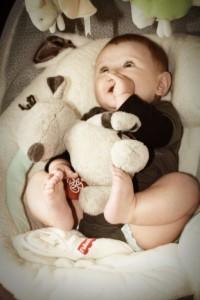 Cute Baby Playing in Fisher Price Papasan Swing
