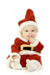 Baby dressed up in santa suit.